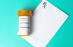 medicine bottle on a prescription pad that typically includes a DEA number for the provider