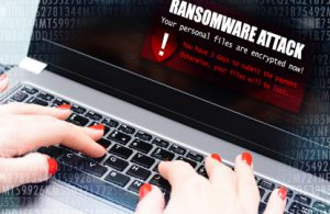 "computer screen displaying the phrase ""ransomware attack"""