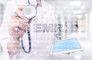 data entry for emr vs ehr represented in an image with a tablet and a stethoscope