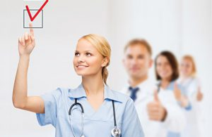 Nurse checking off a mark on an EHR implementation checklist