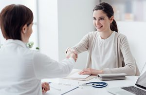 Increasing patient satisfaction with a patient and provider handshake