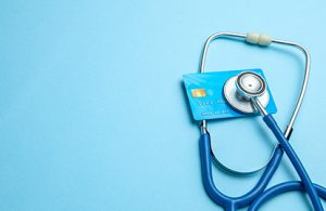 Improve payment collections image with stethoscope and credit card
