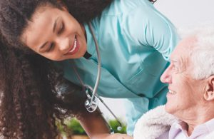Nurse is improving the patient experience by interacting with an elderly patient