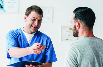 Provider and patient interacting with a clipboard