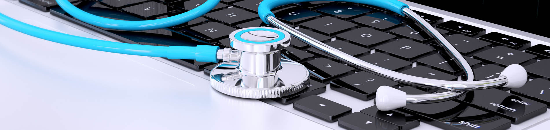 a stethoscope resting on a computer to represent HIPAA addressable and required security measures