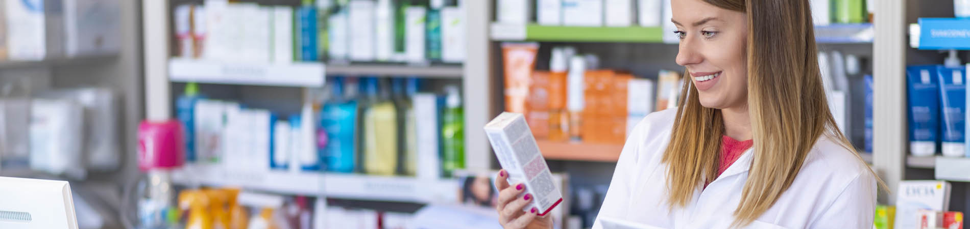 pharmacist uses a tablet to look up an e-prescription and verify dosage